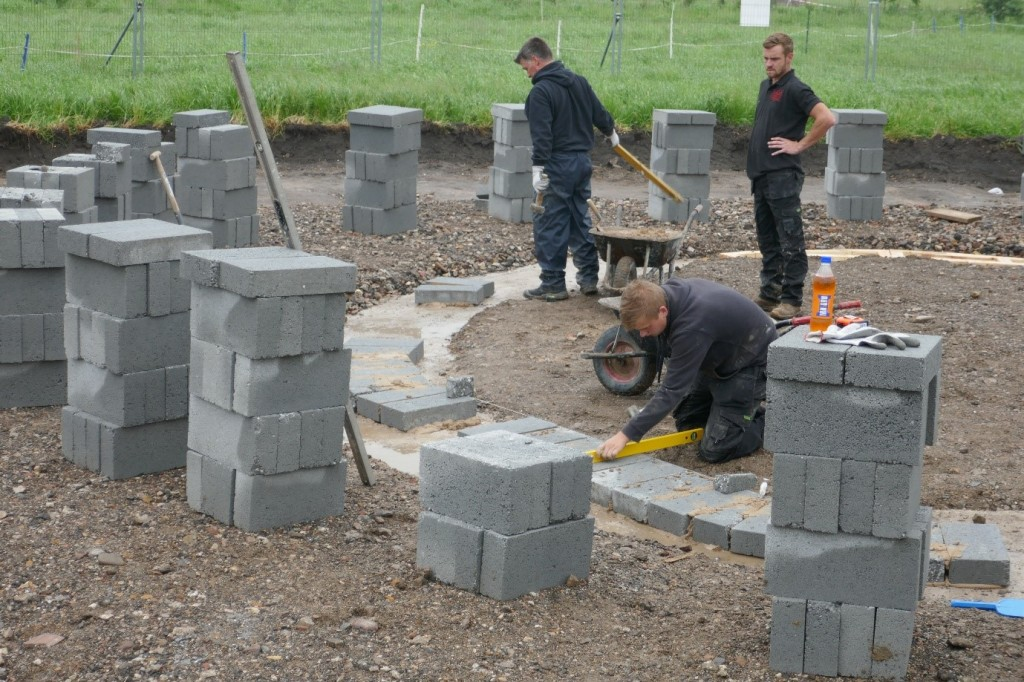 the first blocks being laid
